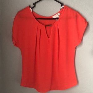 Bright  orange blouse